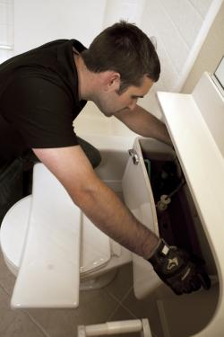 Reed is one of our Bothell toilet installation and repair specialists and he is fixing a broken toilet